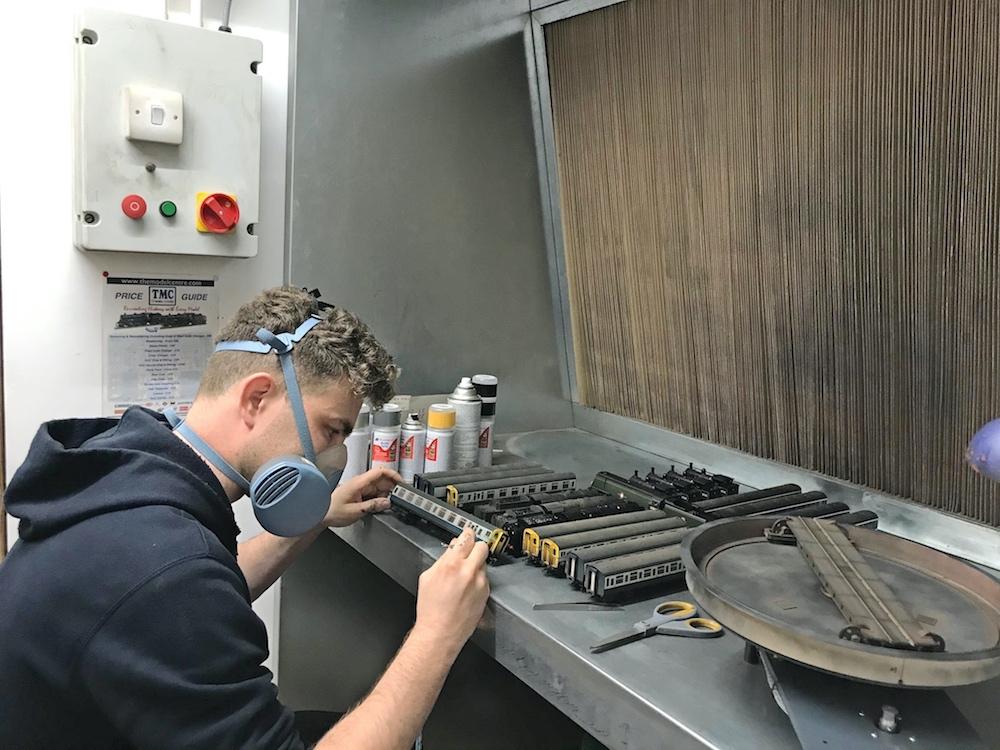 Technician Working on Batch of DMUs